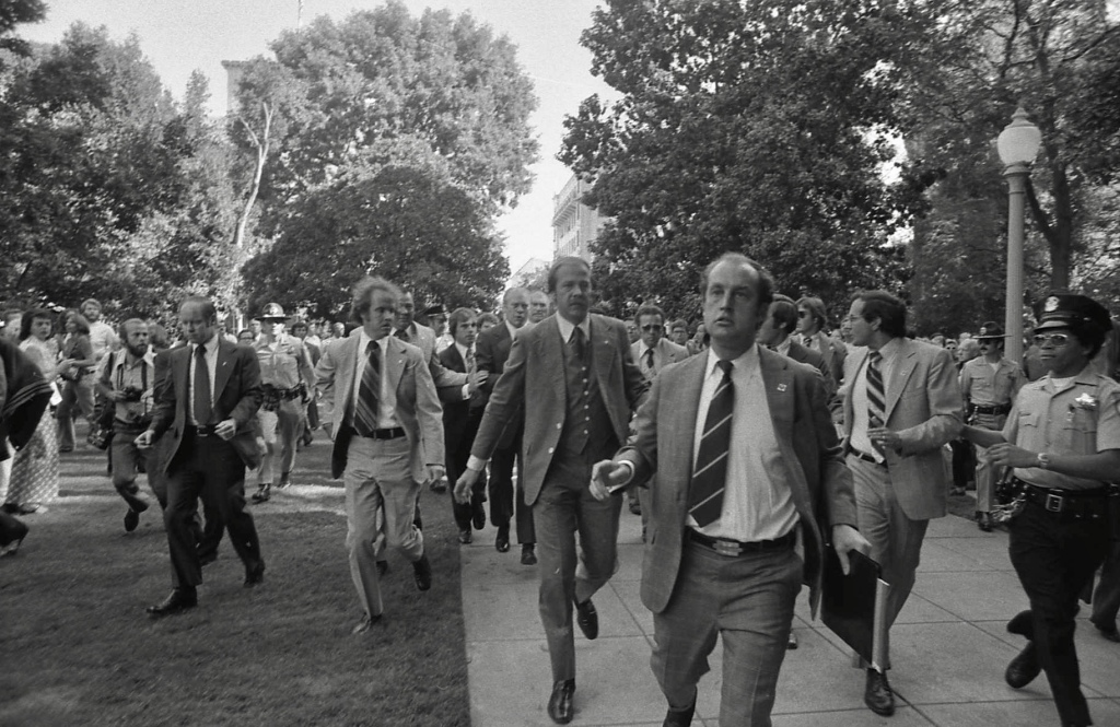 Ford being rushed by U.S. Secret Service from the site of the 1975 attempt on his life in Sacramento, California